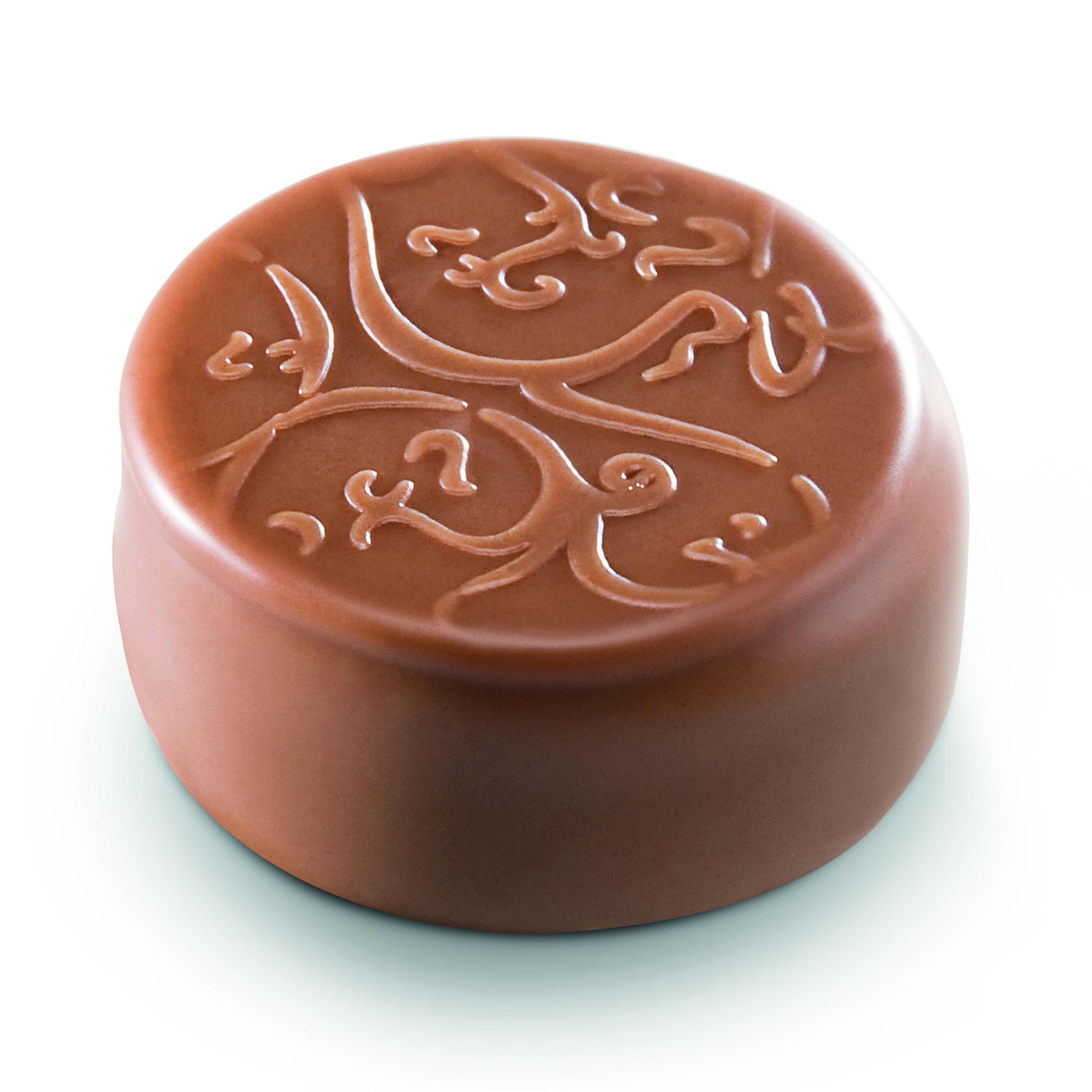 SENSATION CARAFRUTTI COCO - Ganache élaborée à la pulpe de noix de coco caramélisée, enrobée de chocolat au lait. Notes fruitées et caramel. Texture crémeuse.